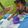 """Amelia Dyer, 3, of Fitchburg, works on the unify Fitchburg art puzzle project at the """"Juneneenth Celebration"""" at Riverfront Park in Fitchburg on Saturday afternoon. SENTINEL & ENTERPRISE / Ashley Green"""