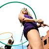 "Kristina Sutcliffe of O Dance, works the hula hoop with  Dena Nishek, in the background, during the Boulder Ciclovia on Pearl Street.<br /> Boulder Green Streets and the City of Boulder  put on the third annual Boulder Ciclovia on Sunday.<br /> For more photos and a video of the Boulder Ciclovia, go to  <a href=""http://www.dailycamera.com"">http://www.dailycamera.com</a>.<br /> Cliff Grassmick  / September 16, 2012"