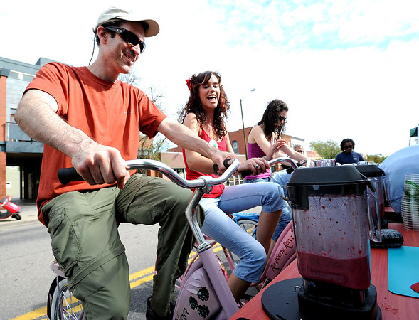 "Jon Caspi, left, Mandy Blosser, and Alli Blosser, all of Ft. Collins, blend their own smoothies with bicycle power at the Boulder Bike Blenders booth at Boulder Ciclovia on Sunday.<br /> Boulder Green Streets and the City of Boulder  put on the third annual Boulder Ciclovia on Sunday.<br /> For more photos and a video of the Boulder Ciclovia, go to  <a href=""http://www.dailycamera.com"">http://www.dailycamera.com</a>.<br /> Cliff Grassmick  / September 16, 2012"