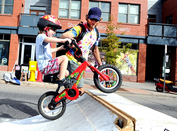 "Linder Ziemba, 3, gets help from his dad, Brian, to get over the bike ramp during the Boulder Ciclovia on Sunday.<br /> Boulder Green Streets and the City of Boulder  put on the third annual Boulder Ciclovia on Sunday.<br /> For more photos and a video of the Boulder Ciclovia, go to  <a href=""http://www.dailycamera.com"">http://www.dailycamera.com</a>.<br /> Cliff Grassmick  / September 16, 2012"