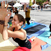 "Amanda Fiorino teaches at yoga class for Angel Organic Studio at the Boulder Ciclovia on Pearl Street.<br /> Boulder Green Streets and the City of Boulder  put on the third annual Boulder Ciclovia on Sunday.<br /> For more photos and a video of the Boulder Ciclovia, go to  <a href=""http://www.dailycamera.com"">http://www.dailycamera.com</a>.<br /> Cliff Grassmick  / September 16, 2012"