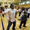 Danny Paulsen, left, and Blake O'Brian put some effort in the makeup for the Thriller dance on Saturday.<br /> A few hundred people danced to Michael Jackson's Thriller at the Paul Derda Recreation  Center to be part of a Guinness World record across the country.<br /> Cliff Grassmick / October 24, 2009