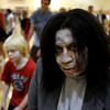 "Alicia Hoegh had a scary ""Thriller"" look for the dance on Saturday.<br /> A few hundred people danced to Michael Jackson's Thriller at the Paul Derda Recreation  Center to be part of a Guinness World record across the country.<br /> Cliff Grassmick / October 24, 2009"