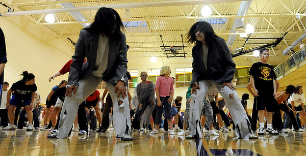 Alicia Hoegh, left, and her twin Lonnie Mercer, had the Thriller look for the record dance on Saturday.<br /> A few hundred people danced to Michael Jackson's Thriller at the Paul Derda Recreation  Center to be part of a Guinness World record across the country.<br /> Cliff Grassmick / October 24, 2009