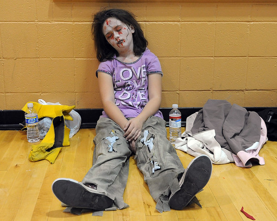 Ashlynn Waite, 9, apparently not thrilled, fell asleep during the rehearsal of the Thriller dance, but she did get in on record attempt.<br /> A few hundred people danced to Michael Jackson's Thriller at the Paul Derda Recreation  Center to be part of a Guinness World record across the country.<br /> Cliff Grassmick / October 24, 2009