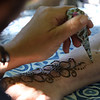 Lawrence Library in Pepperell hosts a socially-distanced tie-dye event, sponsored by Friends of the Lawrence Library. Mandy Roberge of Leominster, whose business is WIcked Good Henna, paints henna designs. (SUN/Julia Malakie)