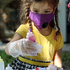 Lawrence Library in Pepperell hosts a socially-distanced tie-dye event, sponsored by Friends of the Lawrence Library. Sabrina Jacinto, 4, of Pepperell, dyes her shirt. (SUN/Julia Malakie)