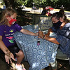 Lawrence Library in Pepperell hosts a socially-distanced tie-dye event, sponsored by Friends of the Lawrence Library. Mandy Roberge of Leominster, whose business is WIcked Good Henna, paints henna designs for Kacie Bourbeau, 9, of Pepperell. (SUN/Julia Malakie)