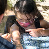 Lawrence Library in Pepperell hosts a socially-distanced tie-dye event, sponsored by Friends of the Lawrence Library. Skyler Walkovich, 5, of Pepperall, get her hand painted with henna by Mandy Roberge of Leominster, whose business is WIcked Good Henna. (SUN/Julia Malakie)