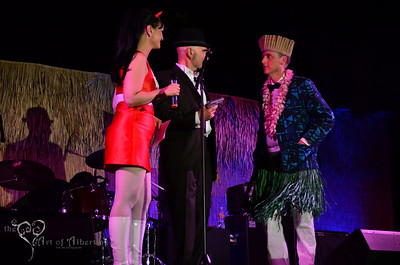 The Love Me Nots performing on the main stage at Tiki Oasis on Friday night. Baby-Doe von Stroheim and Otto von Stroheim with King Kukulele presenting.