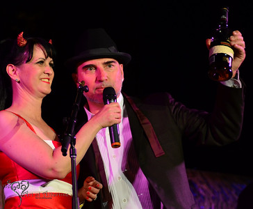 The Love Me Nots performing on the main stage at Tiki Oasis on Friday night. Baby-Doe von Stroheim and Otto von Stroheim presenting.