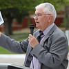 Longtime Chadron State College newsman Con Marshall displays a photo from the archives during his keynote presentation of the Centennial Time Capsule Dedication Ceremony on April 26. The photo portrays an accident by a truck of the Buckingham Freightlines, the company started by an enterprising family with deep CSC ties. (Photo by Justin Haag)