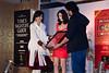 Asha receiving the award from Diya Mirza & Arshad Varsi