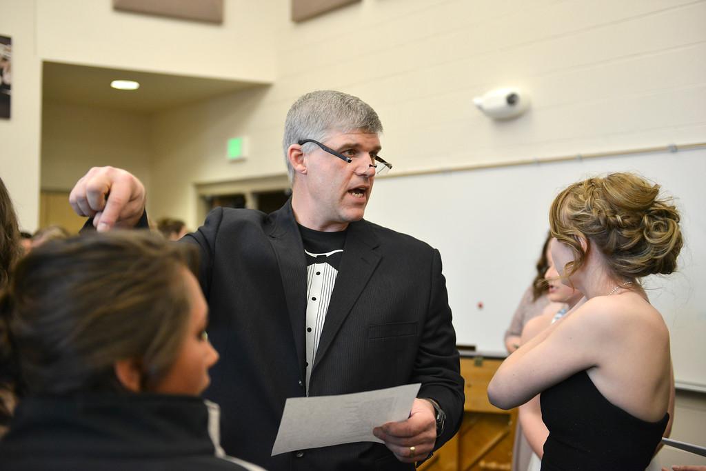 Justin Sheely | The Sheridan Press<br /> Principal Mark Fritz organizes the couples during prom at Tongue River High School Saturday, April 7, 2018.