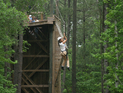 Tiffney Minor, 23, of Suwanee takes a ride on the zip line during Toni's Camp, May 1. The weekend camp allows individuals with physical or mental disabilities to engage in spiritual, social and recreational activities on the grounds of Camp Twin Lakes, Rutledge.   (Page 5, May 27, 2010 issue)