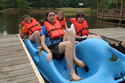Sitting in a paddle boat, (clockwise from front right) camper Suzanne Feaster, volunteer Olivia Gasper, camper Kimberly Crowe and volunteer Jessica Grant prepare to set out onto Lake Selig, the camp's upper lake.  (Page 4, May 27, 2010 issue)