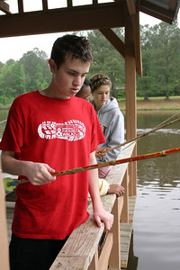 Fifteen-year-old Michael Feliu of St. Oliver Plunkett Church, Snellville, fishes with a bamboo pole in Lake Selig.   (Page 5, May 27, 2010 issue)