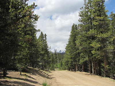 dirt road with mountains by the Boy Scout Camp