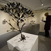 """KRISTOPHER RADDER - BRATTLEBORO REFORMER<br /> Gudrun Weeks works at sculptures from Tori Porter's """"Before Words"""" that is on display at the Mitchell Giddings Fine Art Gallery in Brattleboro, Vt., until June 18, 2017."""