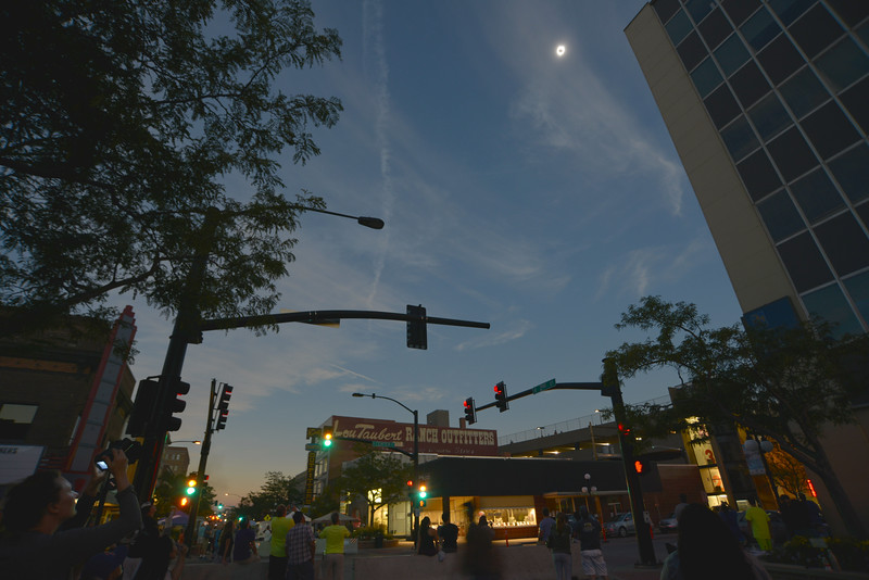 Justin Sheely | The Sheridan Press<br /> The view of the sun is blocked by the moon during the total solar eclipse Monday, August 21, 2017, in downtown Casper, Wyoming.