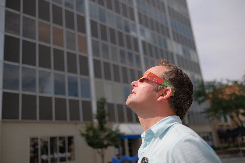 Justin Sheely | The Sheridan Press<br /> Preston Farnsworth of Sheridan, Wyoming, looks at the sun through a pair of solar viewing glasses during the total solar eclipse Monday, August 21, 2017, in downtown Casper, Wyoming.