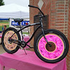 A bicycle with 'donuts' for wheels welcomes participants to the Tour de Donut.