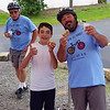 Father and son Tim and Timmy Pappagallo signal that all's well as they enjoy a donut at the first stop on their 30-mile Tour de Donut Bike Tour on Saturday. Behind them is Timmy's grandfather, Wayne Bowen.