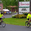 After a stop for a drink and a donut at Apple Castle, a pair of bicyclists head back out onto Route 18 to continue their Tour de Donut trek.