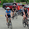 A group of bikers heads up the hill toward Westminster College's Old 77 and out into the streets for the Tour de Donut.