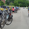 Bicycles are mounted on the backs of vehicles in the parking lot of Westminster College's Memorial Field House, waiting to be unloaded and ridden in the Tour de Donut.