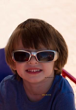 Boy in bike cart sunglasses 0438