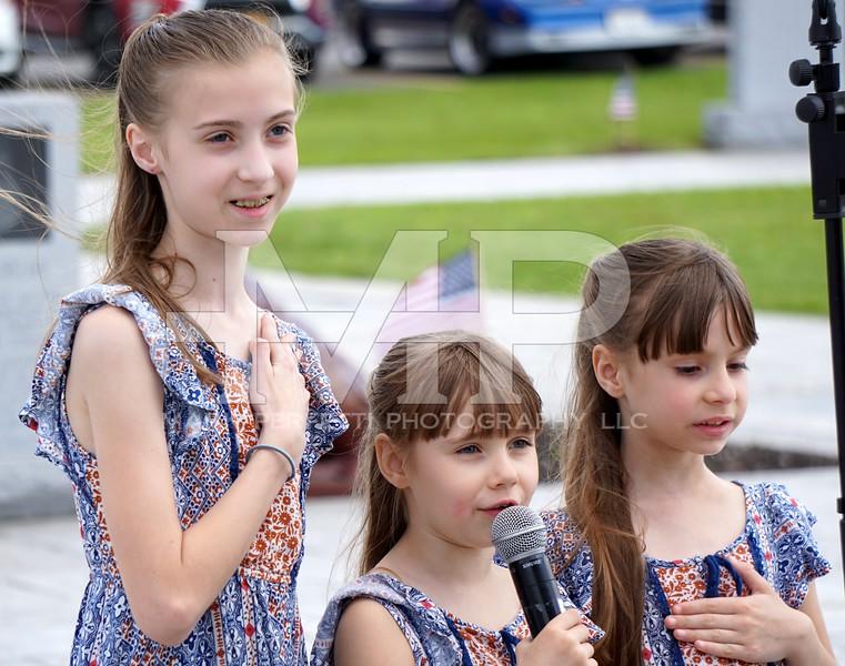Makenzie, Raighen and Ryeli Wilson lead everyone in the Pledge of Allegiance