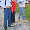 Tom Oughton, Kathleen Oughton and Albert Staleylook at 3 memorial pavers for the Oughton family