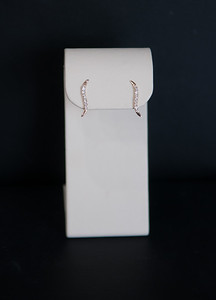 "Item 4: 14K, diamond wave/ ""S"" style earrings."