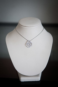 Item 9: Ladies, 14kwg, Venetti diamond pendant & white gold chain.