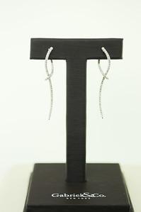 14KWG Fashion Curve Earrings w/ .49cttw Diamonds. $715.00