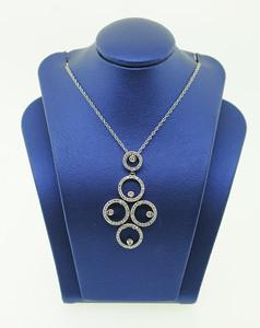 14KWG Pendant w/ .50cttw Diamonds. $575