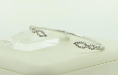 14KWG Diamond Bangle with .59cttw Diamonds. $1,045.00