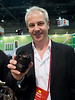Ran into the Editor of Amateur Photographer, Damien Demolder, at the Pentax booth of CES 2012. He was carrying lots of Samsung NX gear and was nice enough to pose with the mighty Samsung 85/1.4 lens.