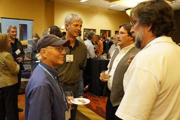 Again the story is networking, communicating, engaging.  Four men in the front, two people to the left, and many others behind them.  Again, the people fill the frame, showing the viewer that the place is filled with people, even if it wasn't.  Find small groups engaged in conversation, then position yourself so that other groups are behind them.  _DSC1517