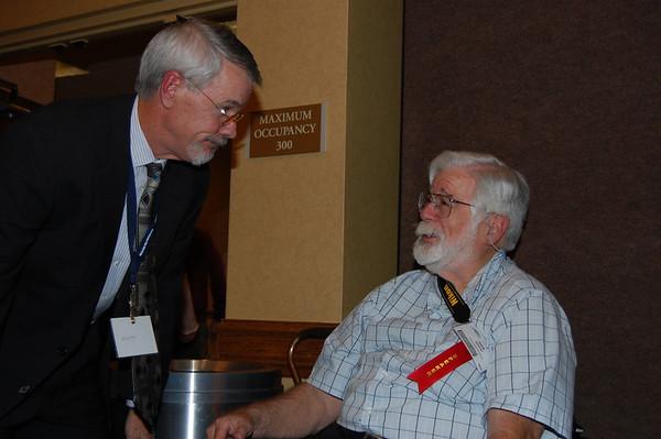 Here we use a strobe in a very dark room, showing speaker Mark Cramer, left socializing with one of his star speakers, Dick Reizner.  DSC_0832