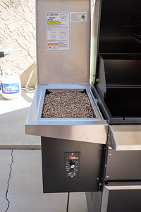 Pellets loaded in the hopper. Electronic control of temperature via pellet feed rate and forced air into the fire box. Thermocouple monitors air temperature in convection oven space to control pellet delivery and air speed.