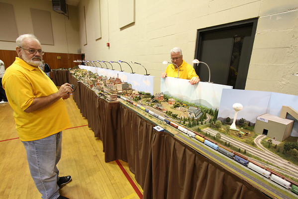 The model train show offers visitors a rare opportunity to see truly impressive and large train layouts with realistically sized trains running.  It is not uncommon to see a 100 car coal train running in N Scale - just as in real life.  Here club member Jerry Prott using a remote control to navigate a long grain train past an automobile plant.