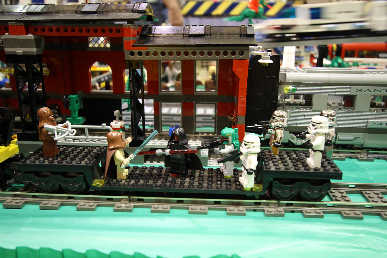 Even Star Wars characters make an appearance on a LEGO train car.
