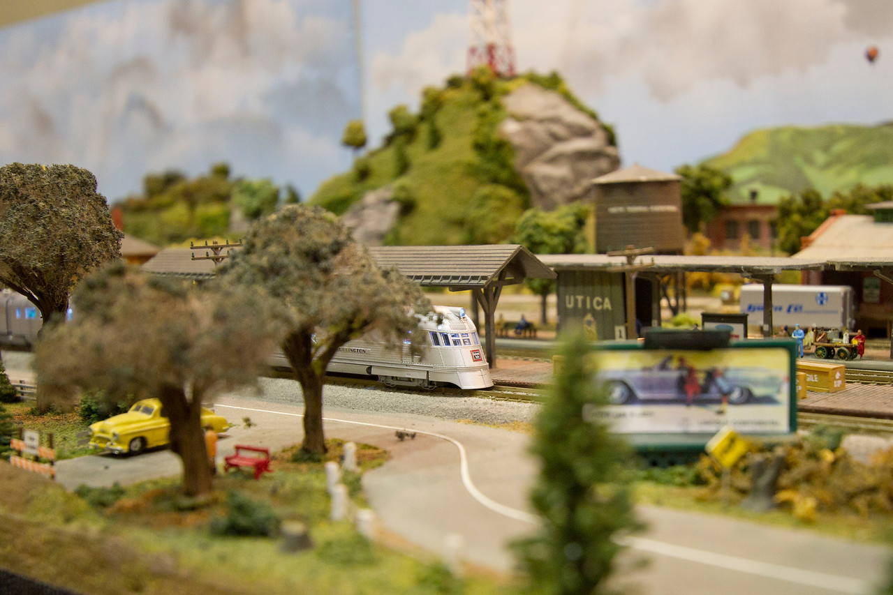 A streamlined Zephyr train in N scale waits for passengers to board at the train station.