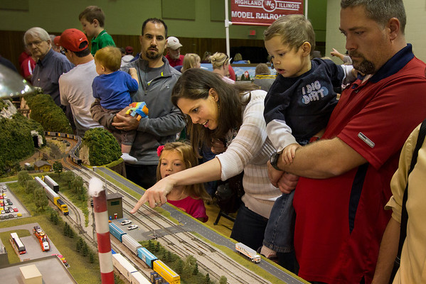 Kids and parents alike are fascinated by the details of the Mississippi Valley N Scalers' modular layout.  Here a mom points out one of the many details of Jeff Coffelt's auto plant modules.