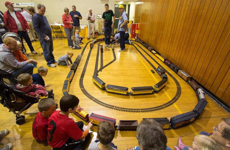 """Children and their parents love getting up close to the G Scale (aka """"Garden Railroad"""") trains.  Careful not to touch that boxcar!  The train on the outside track is being pulled by a replica """"Big Boy"""" engine with smoke.  To my knowledge, the Big Boy was the largest steam locomotive - with a boiler so large that it had to be articulated in order to go around curves (this replica is also articulated).  The G Scale Big Boy engine is extremely rare and very expensive!  You can see its big brother (the real engine) at the Museum of Transportation in St. Louis."""