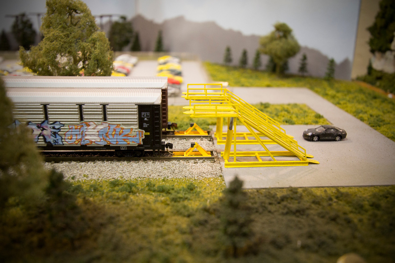 As in real life, automobiles would be loaded on train cars using ramps - in this case, tiny ramps hand made by the Jeff Coffelt.