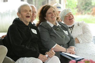 (L-r) Father Luke Kot, one of the founding members of the Conyers monastery, Rose Campbell, the monastery infirmary's head nurse and infirmary volunteer Martha Crima laugh as Abbot Francis Michael Stiteler, OCSO, shares a funny story during his talk.  (Page 12, May 27, 2010 issue)