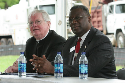 J. Kevin Boland, the current bishop of the Diocese of Savannah, left, and Rockdale County Commissioner Richard Oden listen to one of nine speakers during the Monastic Heritage Center groundbreaking program. The monks came to Conyers in 1944 at the invitation of the Bishop of Savannah.